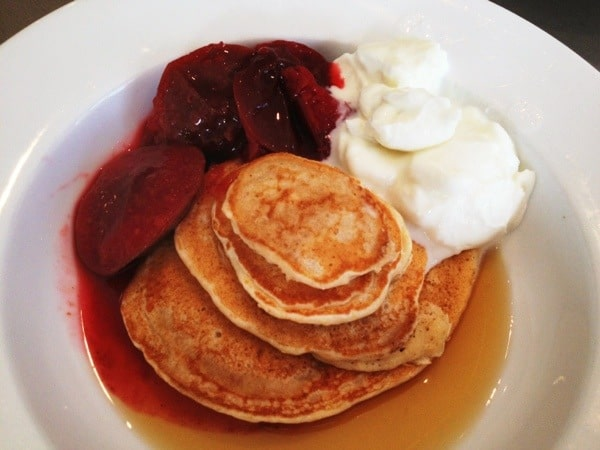 healthy wholemeal pancakes with plums and yoghurt