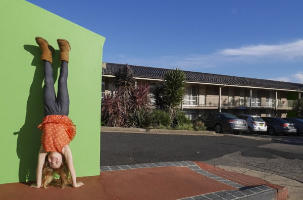 Ibis Styles orange handstand