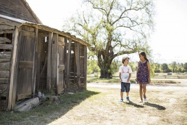 Kids walking next to a farm outbuilding, Rouse Hill House & Farm