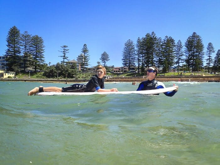 This image has an empty alt attribute; its file name is Sydney-learn-to-surf-700x525.jpg
