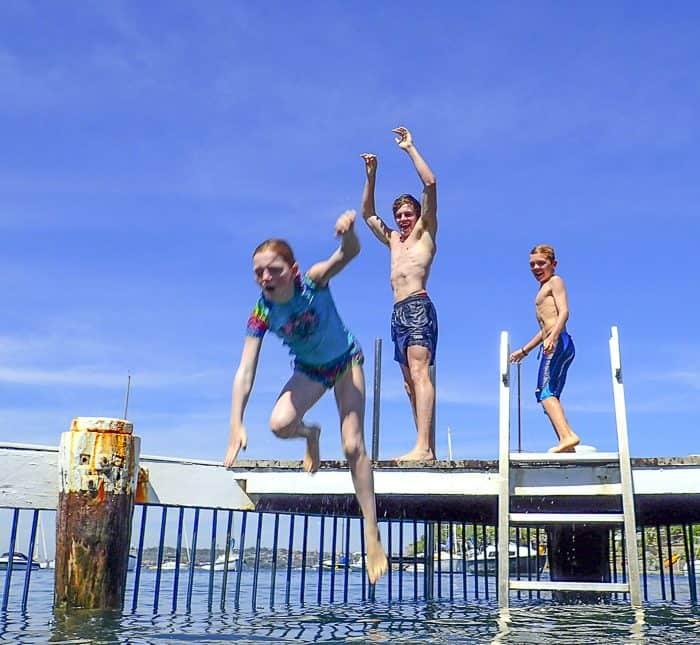 little manly beach kids jump in from shark net