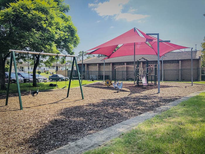 Playground swings at Riverstone Swimming Centre