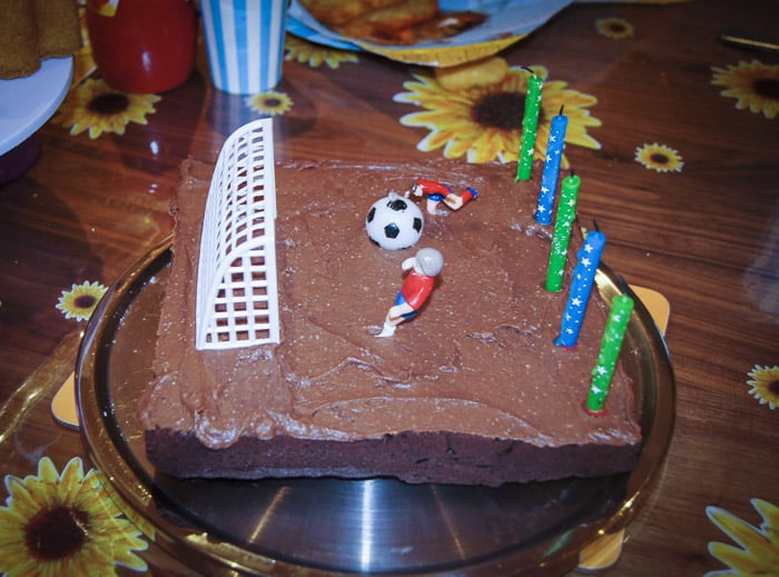 chocolate and beetroot cake with football figures on top