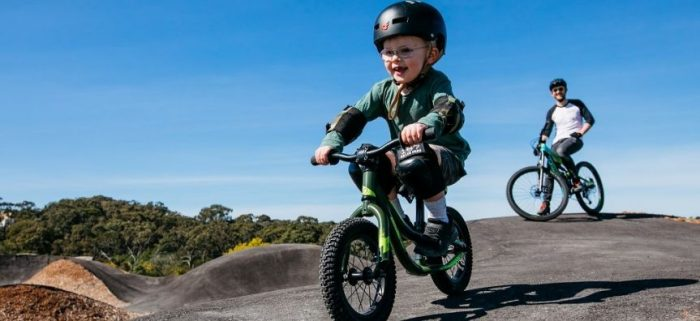 young boy on mountain bike on beginner tracks at Bare Creek Bike Park in belrose Sydney
