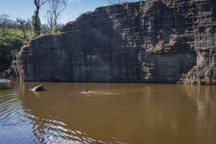 Clarence dam blue mountains man swimming far off